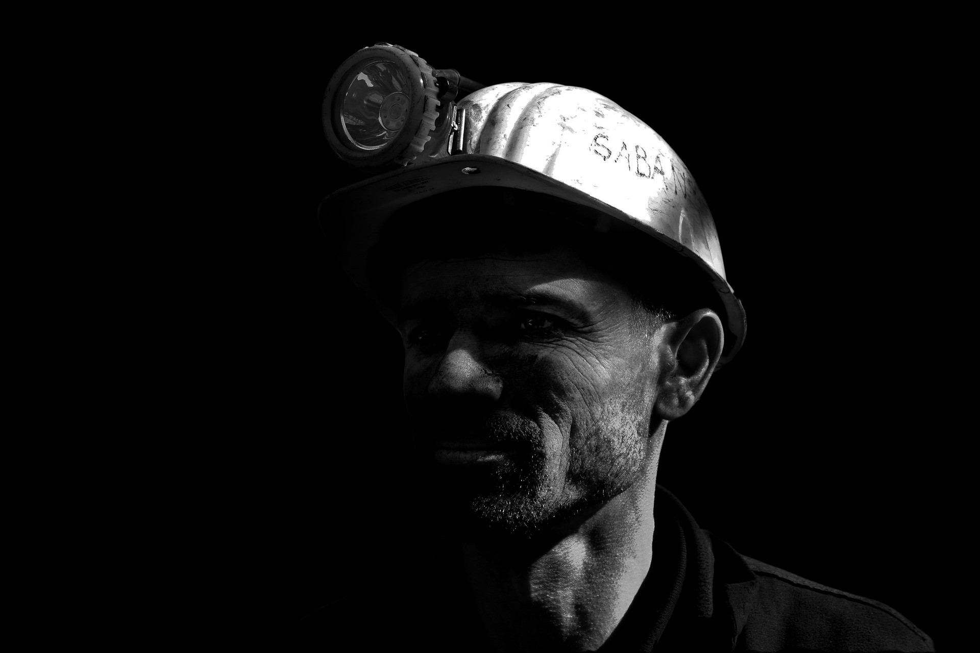 Black and white photograph of a miner