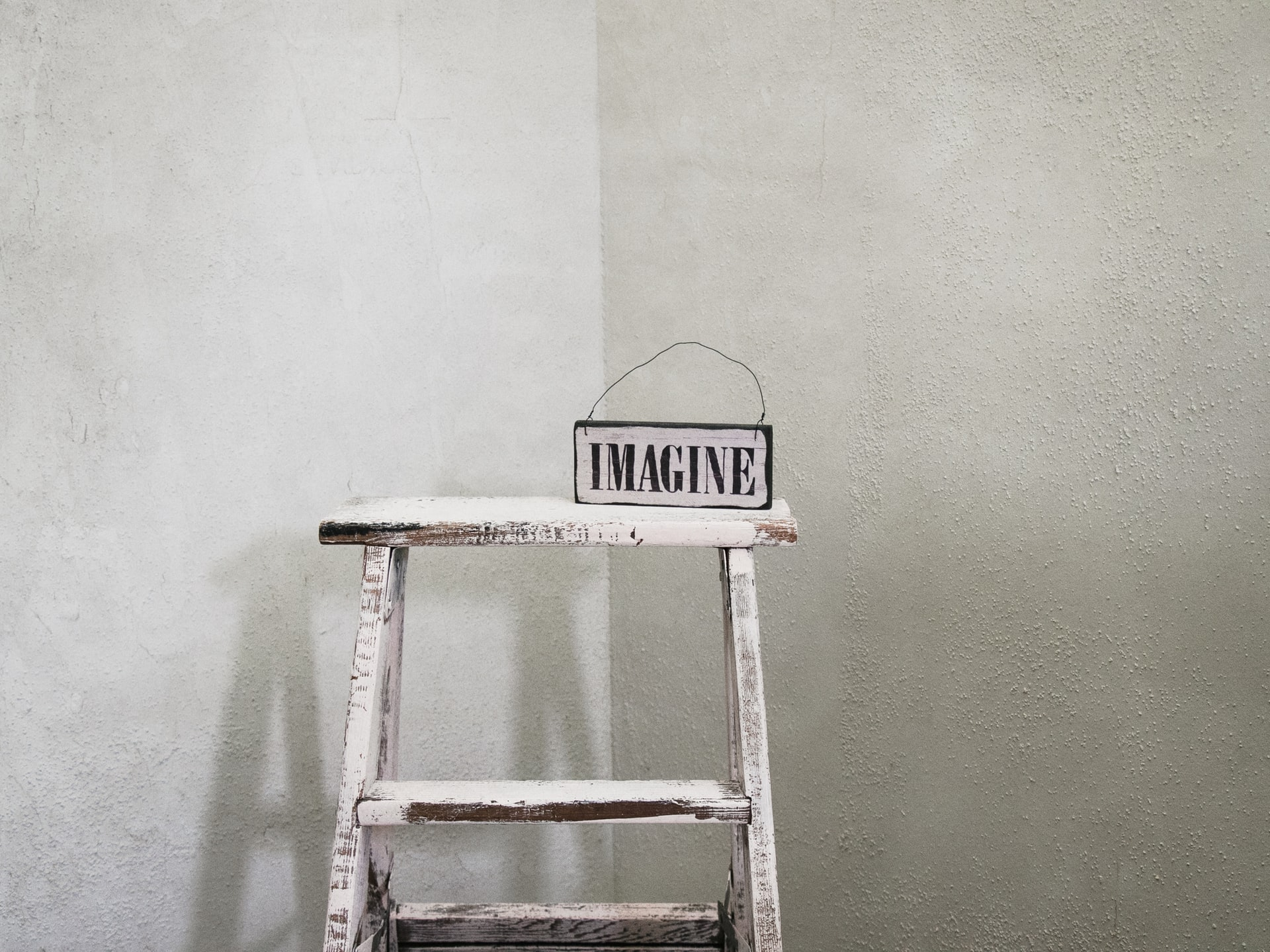 Ladder with the word imagine on the top step